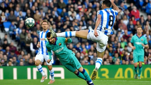 <p>               Real Sociedad's Mikel Merino, right, leaps to block a header from Barcelona's Lionel Messi during the Spanish La Liga soccer match between Real Sociedad and Barcelona, at Anoeta stadium, in San Sebastian, Spain, Saturday, Dec. 14, 2019. (AP Photo/Alvaro Barrientos)             </p>