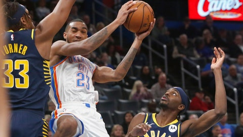 <p>               Oklahoma City Thunder guard Terrance Ferguson (23) goes to the basket between Indiana Pacers center Myles Turner (33) and forward Justin Holiday during the second half of an NBA basketball game Wednesday, Dec. 4, 2019, in Oklahoma City. (AP Photo/Sue Ogrocki)             </p>