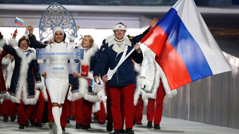 <p>               FILE - In this Feb. 7, 2014 file photo Alexander Zubkov of Russia carries the national flag as he leads the team during the opening ceremony of the 2014 Winter Olympics in Sochi, Russia. at left is model Irina Shayk carrying the Russian placard. (AP Photo/Mark Humphrey, file)             </p>