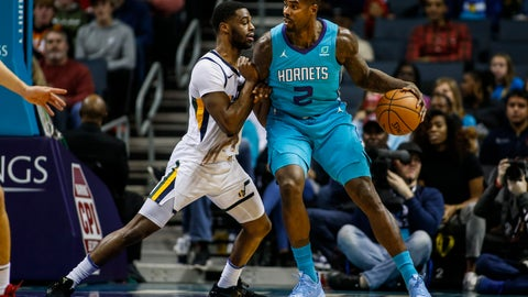 <p>               Charlotte Hornets forward Marvin Williams, right, drives into Utah Jazz guard Emmanuel Mudiay in the first half of an NBA basketball game in Charlotte, N.C., Saturday, Dec. 21, 2019. (AP Photo/Nell Redmond)             </p>