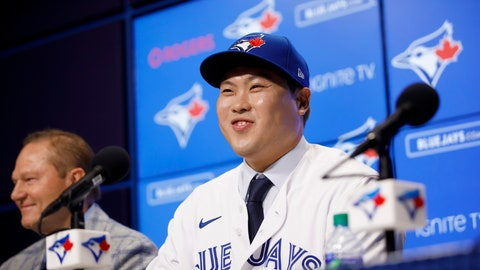 <p>               Toronto Blue Jays newly signed pitcher Hyun-Jin Ryu, right, smiles as he speaks to media at a news conference announcing his signing to the team in Toronto, Friday, Dec. 27, 2019. (Cole Burston/The Canadian Press via AP)             </p>
