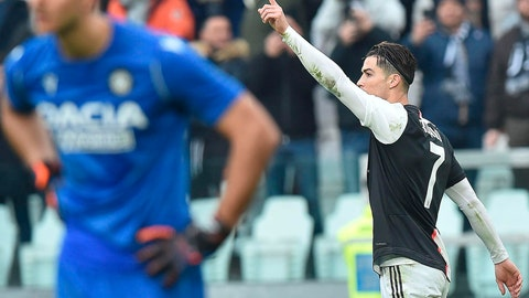 <p>               Juventus' Cristiano Ronaldo, right, celebrates after scoring his second goal during the Italian Serie A soccer match between Juventus and Udinese at the Allianz Stadium in Turin, Italy, Sunday, Dec. 15, 2019. (Alessandro Di Marco/ANSA via AP)             </p>