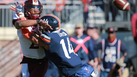 <p>               Virginia Tech quarterback Hendon Hooker (2) is hit by Virginia linebacker Noah Taylor (14) as he throws the ball during the first half of an NCAA college football game between Virginia Tech and Virginia in Charlottesville, Va., Friday, Nov. 29, 2019. (AP Photo/Steve Helber)             </p>