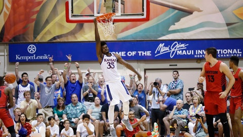 <p>               Kansas center Udoka Azubuike (35) hangs off the rim after making a slam dunk over Dayton in overtime of an NCAA college basketball game Wednesday, Nov. 27, 2019, in Lahaina, Hawaii. Kansas defeated Dayton in 90-84 in overtime. (AP Photo/Marco Garcia)             </p>