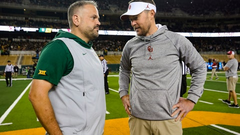 <p>               FILE - In this Nov. 16, 2019, file photo, Baylor head coach Matt Rhule, left, and Oklahoma head coach Lincoln Riley talk at midfield prior to an NCAA college football game in Waco, Texas. Rhule and Riley took over their teams under drastically different circumstances. Now they will coach against each other in the Big 12 championship game. (AP Photo/Ray Carlin, File)             </p>