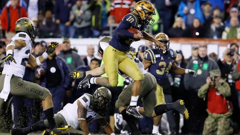 <p>               Navy's Malcolm Perry (10) leaps over Army's Donavan Lynch (11) during the second half of an NCAA college football game, Saturday, Dec. 14, 2019, in Philadelphia. (AP Photo/Matt Slocum)             </p>