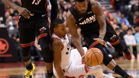 <p>               Miami Heat forward Jimmy Butler (22) drives past Toronto Raptors guard Norman Powell during the second half of an NBA basketball game Tuesday, Dec. 3, 2019, in Toronto. (Nathan Denette/The Canadian Press via AP)             </p>