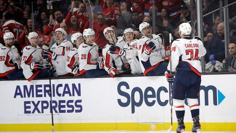 <p>               Washington Capitals' John Carlson (74) celebrates his goal with teammates on the bench during the first period of an NHL hockey game against the Los Angeles Kings Wednesday, Dec. 4, 2019, in Los Angeles. (AP Photo/Marcio Jose Sanchez)             </p>