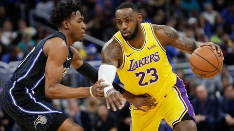 <p>               Los Angeles Lakers' LeBron James (23) drives around Orlando Magic's Wes Iwundu, left, during the first half of an NBA basketball game, Wednesday, Dec. 11, 2019, in Orlando, Fla. (AP Photo/John Raoux)             </p>