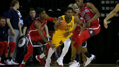 <p>               Baylor guard Davion Mitchell (45) tries to get past Arizona guard Dylan Smith (3) and Arizona center Christian Koloko (35) during the first half of an NCAA college basketball game in Waco, Texas, Saturday, Dec. 7, 2019. (AP Photo/Michael Ainsworth)             </p>