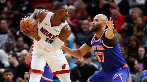 <p>               Miami Heat center Bam Adebayo (13) looks for an open teammate past New York Knicks forward Taj Gibson (67) during the first half of an NBA basketball game Friday, Dec. 20, 2019, in Miami. (AP Photo/Wilfredo Lee)             </p>
