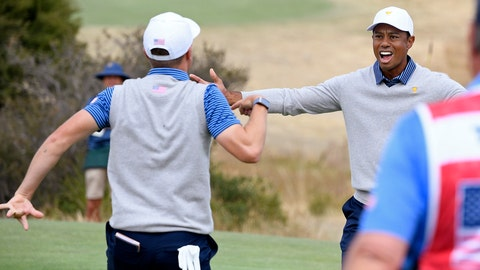<p>               U.S. team player Justin Thomas, left, celebrates with his playing partner and captain, Tiger Woods, on the 18th green in their foursomes match during the President's Cup golf tournament at Royal Melbourne Golf Club in Melbourne, Friday, Dec. 13, 2019. (AP Photo/Andy Brownbill)             </p>