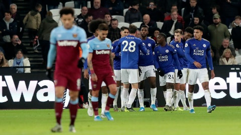 <p>               Leicester's Kelechi Iheanacho celebrates with teammates after scoring his side's opening goal during the English Premier League soccer match between West Ham Utd and Leicester City at the London Stadium in London, Saturday, Dec. 28, 2019. (AP Photo/Petros Karadjias)             </p>