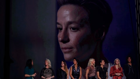 <p>               US Megan Rapinoe is seen on the screen after she awarded as the best female soccer player during the Golden Ball award ceremony at the Grand Palais in Paris, Monday, Dec. 2, 2019. Awarded every year by France Football magazine since Stanley Matthews won it in 1956, the Ballon d'Or, Golden Ball for the best player of the year will be given to both a woman and a man. (AP Photo/Francois Mori)             </p>