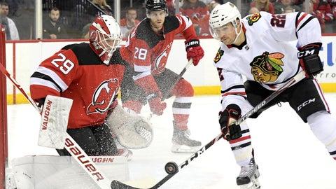 <p>               Chicago Blackhawks center Ryan Carpenter (22) skates in against New Jersey Devils goaltender Mackenzie Blackwood (29) during the first period of an NHL hockey game Friday, Dec. 6, 2019, in Newark, N.J. (AP Photo/Bill Kostroun)             </p>