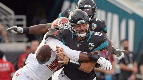 <p>               Tampa Bay Buccaneers linebacker Sam Acho, left, forces a fumble as he sacks Jacksonville Jaguars quarterback Gardner Minshew (15) during the second half of an NFL football game, Sunday, Dec. 1, 2019, in Jacksonville, Fla. (AP Photo/Phelan M. Ebenhack)             </p>