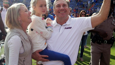 <p>               Florida head coach Dan Mullen, right, celebrates with his wife, Megan, left, and daughter Breelyn in front of fans after defeating Vanderbilt in an NCAA college football game, Saturday, Nov. 9, 2019, in Gainesville, Fla. (AP Photo/John Raoux)             </p>