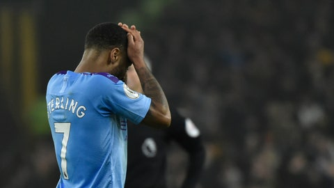 <p>               Manchester City's Raheem Sterling touches his face after Wolverhampton Wanderers' Matt Doherty at the end of an English Premier League soccer match between Wolverhampton Wanderers and Manchester City at the Molineux Stadium in Wolverhampton, England, Friday, Dec. 27, 2019. Wolverhampton Wanderers won 3-2. (AP Photo/Rui Vieira)             </p>