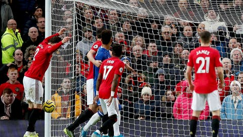 <p>               Manchester United's Victor Lindelof, left, scores an own goal, giving Everton their first goal of the game during the English Premier League match between Manchester United and Everton at Old Trafford, Manchester, England, Sunday, Dec. 15, 2019. (Martin Rickett/PA via AP)             </p>