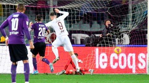 <p>               As Roma's Edin Dzeko (9) scores a goal during an Italian Serie A soccer match against ACF Fiorentina, Friday, Dec. 20, 2019, at the Artemio Franchi stadium in Florence, Italy. (Claudio Giovannini/ANSA via AP)             </p>