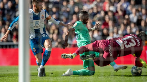 <p>               Real Madrid's Vinicius Junior, center, duels for the ball against Espanyol's David Lopez, left, and Espanyol's goalkeeper Diego Lopez during a Spanish La Liga soccer match between Real Madrid and RCD Espanyol at the Santiago Bernabeu stadium in Madrid, Saturday Dec. 7, 2019. (AP Photo/Bernat Armangue)             </p>