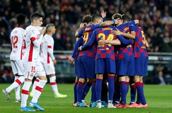 Barcelona routs Mallorca 5-2 with Messi hat