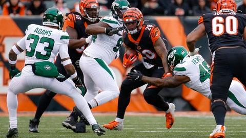 <p>               Cincinnati Bengals running back Joe Mixon (28) runs the ball against New York Jets outside linebacker Jordan Jenkins (48) and strong safety Jamal Adams (33) during the first half of an NFL football game, Sunday, Dec. 1, 2019, in Cincinnati. (AP Photo/Frank Victores)             </p>