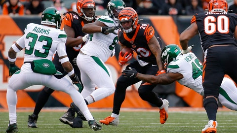 <p>               Cincinnati Bengals running back Joe Mixon (28) runs the ball against New York Jets outside linebacker Jordan Jenkins (48) and strong safety Jamal Adams (33) during the first half of an NFL football game, Sunday, Dec. 1, 2019, in Cincinnati. (AP Photo/Frank Victores)             </p>