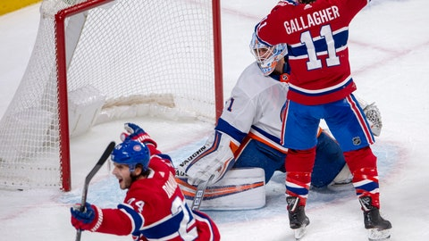 <p>               Montreal Canadiens wingers Phillip Danault (24) and Brendan Gallagher (11) celebrate after Danault scored the first goal against New York Islanders goaltender Thomas Greiss (1) during first period NHL hockey action, Tuesday, Dec. 3, 2019 in Montreal. (Ryan Remiorz/The Canadian Press via AP)             </p>