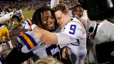 <p>               LSU quarterback Joe Burrow (9) hugs guard Damien Lewis after the team's NCAA college football game against Texas A&M in Baton Rouge, La., Saturday, Nov. 30, 2019. LSU won 50-7. (AP Photo/Gerald Herbert)             </p>