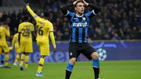 <p>               Inter Milan's Lautaro Martinez, right, reacts after a missed scoring opportunity during the Champions League, group F soccer match between Inter Milan and F.C. Barcelona, at the San Siro stadium in Milan, Italy, Tuesday, Dec. 10, 2019. (AP Photo/Luca Bruno)             </p>