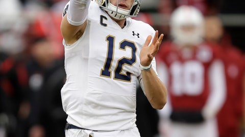 <p>               Notre Dame quarterback Ian Book passes against Stanford in the first half of an NCAA college football game Saturday, Nov. 30, 2019, in Stanford, Calif. (AP Photo/Ben Margot)             </p>