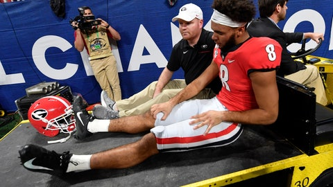 <p>               Georgia wide receiver Dominick Blaylock (8) is taken out of the game due to injury against LSU during the first half of the Southeastern Conference championship NCAA college football game, Saturday, Dec. 7, 2019, in Atlanta. (AP Photo/John Amis)             </p>