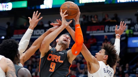 <p>               Orlando Magic center Nikola Vucevic (9) is fouled as he battles under the basket against New Orleans Pelicans center Jaxson Hayes (10) in the first half of an NBA basketball game in New Orleans, Sunday, Dec. 15, 2019. (AP Photo/Gerald Herbert)             </p>