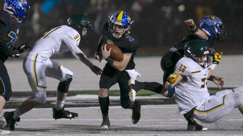 <p>               Sutter Union's Cory McIntyre, center, runs past Paradise's Josh Alvies, left, and Ashton Wagner, right, during the first quarter of a Northern Section Division III high school football playoff game in Yuba City, Calif., Saturday, Nov. 30, 2019. Paradise had an undefeated season and made it to the section championship game a year after the deadliest wildfire in California history that killed dozens and destroyed nearly 19,000 buildings including the homes of most of the players. (AP Photo/Rich Pedroncelli)             </p>