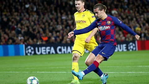 <p>               Corrects goal number, Barcelona's Antoine Griezmann scores his side's third goal during a Champions League group F soccer match between Barcelona and Dortmund at the Camp Nou stadium in Barcelona, Spain, Wednesday, Nov. 27, 2019. (AP Photo/Emilio Morenatti)             </p>