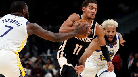 <p>               Atlanta Hawks guard Trae Young (11) drives between Golden State Warriors' Eric Paschall (7) and Ky Bowman (12) in the first half of an NBA basketball game Monday, Dec. 2, 2019, in Atlanta. (AP Photo/John Bazemore)             </p>