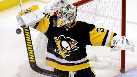<p>               Pittsburgh Penguins goaltender Tristan Jarry stops a shot during the first period of an NHL hockey game against the Montreal Canadiens in Pittsburgh, Tuesday, Dec. 10, 2019. (AP Photo/Gene J. Puskar)             </p>