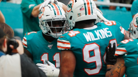 <p>               Miami Dolphins defensive tackle Christian Wilkins (94) congratulates wide receiver DeVante Parker (11), after Parker scored a touchdown, during the first half at an NFL football game against the Philadelphia Eagles, Sunday, Dec. 1, 2019, in Miami Gardens, Fla. (AP Photo/Brynn Anderson)             </p>