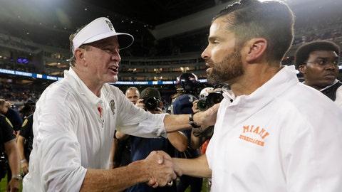 <p>               FIU head coach Butch Davis, left, shakes hands with Miami head coach Manny Diaz after an NCAA college football game, Saturday, Nov. 23, 2019, in Miami. FIU won 30-24. (AP Photo/Lynne Sladky)             </p>