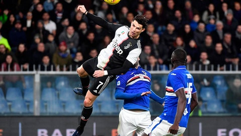 <p>               Juventus' Cristiano Ronaldo, top, scores his side's second goal during a Serie A soccer match between Sampdoria and Juventus, at Luigi Ferraris stadium in Genoa, Italy, Wednesday, Dec. 18, 2019. (Luca Zennaro/ANSA via AP)             </p>