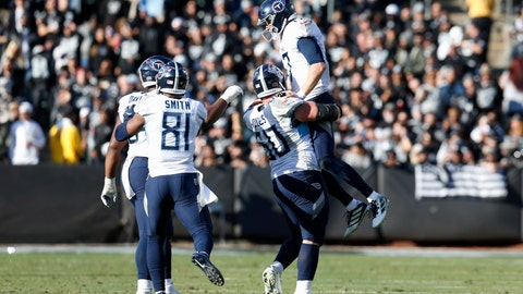<p>               Tennessee Titans quarterback Ryan Tannehill, top, celebrates with teammates after throwing a touchdown pass to wide receiver A.J. Brown against the Oakland Raiders during the first half of an NFL football game in Oakland, Calif., Sunday, Dec. 8, 2019. (AP Photo/D. Ross Cameron)             </p>