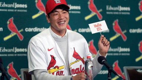 <p>               St. Louis Cardinals pitcher Kwang-Hyun Kim smiles as he holds up a sign during a news conference Tuesday, Dec. 17, 2019, in St. Louis. The Cardinals have signed the Korean left-hander to a two-year contract. (AP Photo/Jeff Roberson)             </p>