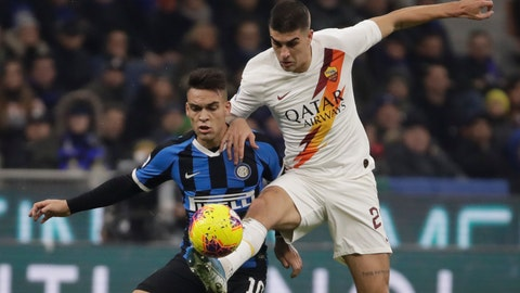 <p>               Inter Milan's Lautaro Martinez, left, vies for the ball with Roma's Gianluca Mancini during a Serie A soccer match between Inter Milan and Roma, at the San Siro stadium in Milan, Italy, Friday, Dec.6, 2019. (AP Photo/Luca Bruno)             </p>