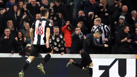 <p>               Newcastle United's Miguel Almiron, right, celebrates scoring his side's first goal of the game, during the English Premier League soccer match between Newcastle United and Crystal Palace, at St James' Park, in Newcastle, England, Saturday, Dec. 21, 2019. (Owen Humphreys/PA via AP)             </p>