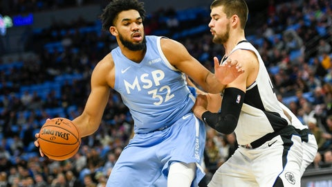 <p>               Minnesota Timberwolves center Karl-Anthony Towns (32) tries to drive past Los Angeles Clippers center Ivica Zubac during the first half of an NBA basketball game Friday, Dec. 13, 2019, in Minneapolis. (AP Photo/Craig Lassig)             </p>