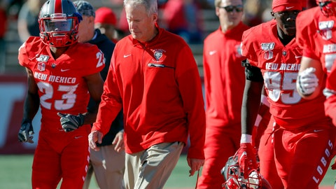 <p>               FILE - In this Saturday, Oct. 26, 2019, file photo, New Mexico coach Bob Davie leads his team from the field at halftime of an NCAA college football game against Hawaii in Albuquerque, N.M. On Monday, Nov. 25, Davie agreed to step aside as New Mexico's coach at the end of the season, ending an uneven eight-season tenure with the Lobos. (AP Photo/Andres Leighton, File)             </p>