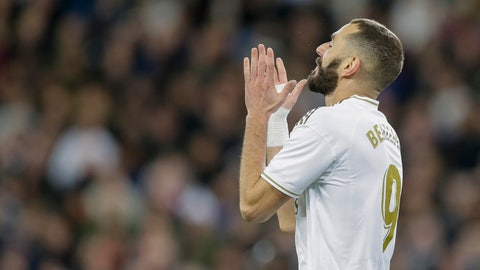 <p>               Real Madrid's Karim Benzema reacts after failing a scoring chance during a Spanish La Liga soccer match between Real Madrid and Athletic Bilbao at the Santiago Bernabeu stadium in Madrid, Spain, Sunday Dec. 22, 2019. (AP Photo/Paul White)             </p>
