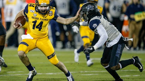 <p>               Kent State quarterback Dustin Crum (14) carries the ball as Utah State safety Troy Lefeged Jr. (3) defends during the first half of the Frisco Bowl NCAA college football game Friday, Dec. 20, 2019, in Frisco, Texas. (AP Photo/Brandon Wade)             </p>