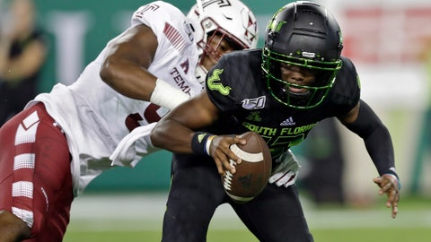 <p>               File-This Nov. 7, 2019, file photo shows South Florida quarterback Jordan McCloud (12) eluding a sack by Temple defensive end Quincy Roche during the first half of an NCAA college football game in Tampa, Fla. Roche was named American Athletic Conference Defensive Player of the Year after ringing up 13 sacks, including 10 in the Owls' final four games. In a pivotal victory over then No. 21 Maryland, the 6-foot-4, 235-pounder had a sack, a blocked kick and six tackles. (AP Photo/Chris O'Meara, File)             </p>